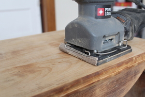 An orbital sander saves you a lot of effort. Bite the bullet and buy one, or you'll wish you did when you're an hour into sanding by hand.